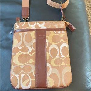 Coach crossbody monogrammed purse